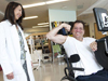 Maria R. Reyes, M.D., assist Joseph Preti in building upper body strength.