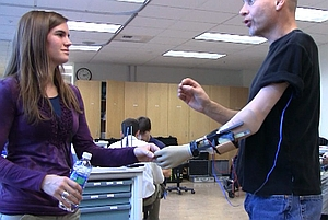 Student and patient with prosthetic hand